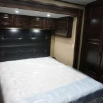 Queen Bed with Padded Headboard & Overhead Storage